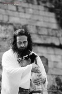 Jesus hugging girl